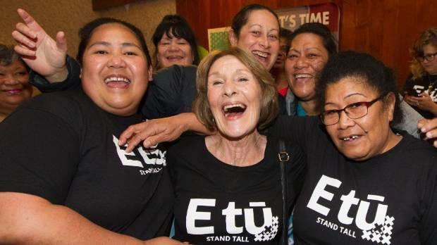 Telani Esene, left, Kristine Bartlett and Eneata Apineru celebrate the historic pay equity settlement in Wellington.