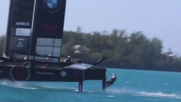 Oracle Team USA skipper Jimmy Spithill falls overboard in practice for America's Cup racing in Bermuda.