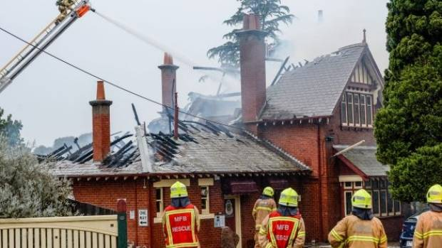 Firefighters assess the damage to the Ivanhoe RSL on Friday morning.