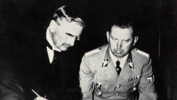British Prime Minister Neville Chamberlain signs the Munich agreement in 1938, an attempt to prevent war. He pursued the ...