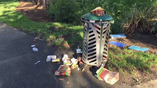 A rubbish bin overflows in Whangarei, as freedom campers flock to the area.