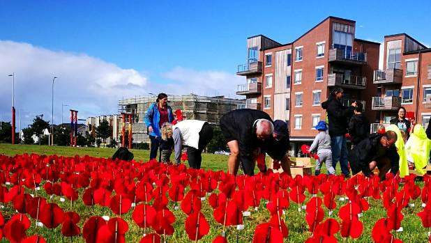 Residents could come and help place the poppies for up to an hour and a half.