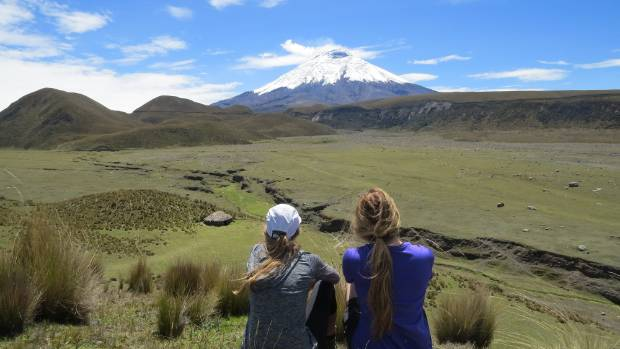 This photo was taken by our teacher as my friend and I posed on the top of this hill overlooking the Cotopaxi volcano, ...
