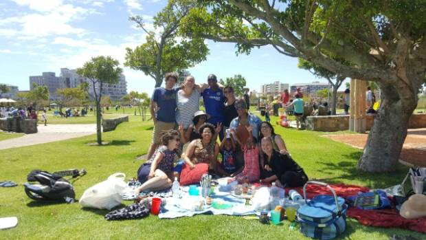 Francesca (second from right) and friends enjoying a picnic in Greenpoint Park.
