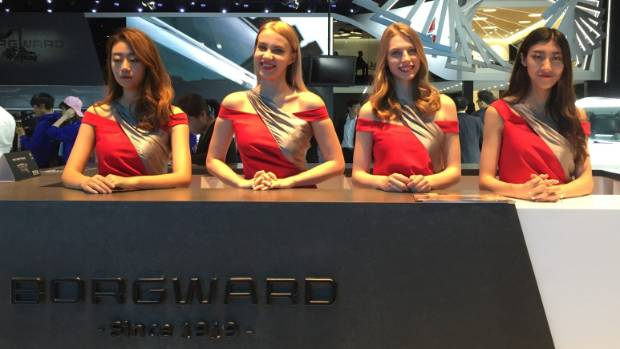 Who really doesn't want to be there? Body language on display at the Borgward stand at the 2017 Shanghai Motor Show.