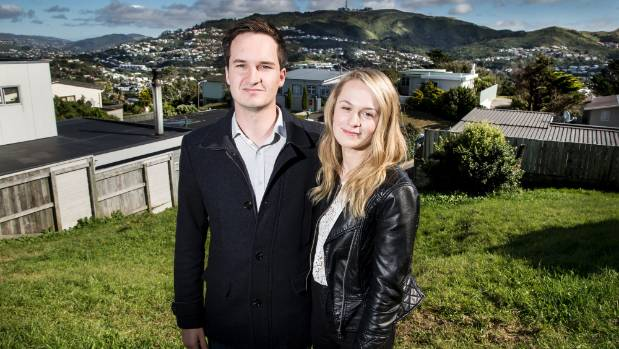 Aiden McGillicuddy and Zoe Robinson on the section they bought in the Wellington suburb of Newlands. With house prices ...