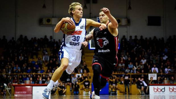 Giants guard Kyle Adnam drives past Jeremy Kendle in Christchurch on Friday night.