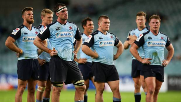 The dejected NSW Waratahs players failed to take advantage of the ACT Brumbies' loss to the Hurricanes earlier in the night.