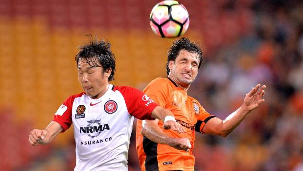 Thomas Broich of the Roar (right) and Jumpei Kusukami of the Wanderers challenge for the ball during the A-League ...