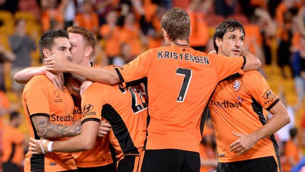 Jamie Maclaren (obscured) is congratulated by Brisbane Roar teammates after scoring a second-half goal to tie the game.