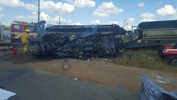 What caused the minibus to collide with a truck remains unclear.