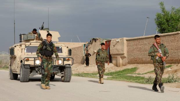 Afghan National Army (ANA) troops arrive near the site of an ongoing attack on an army headquarters in Mazar-i-Sharif.