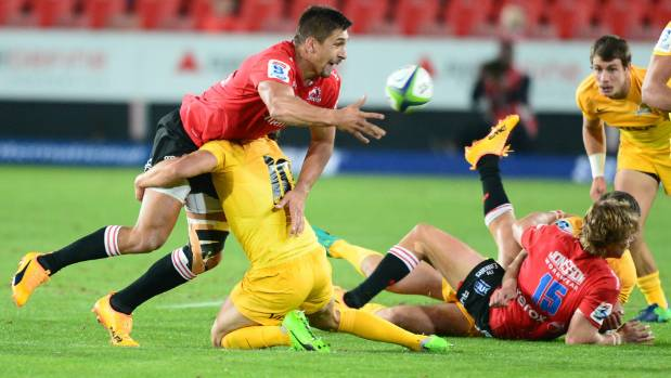 Harold Vorster of the Lions passes the ball as the Jaguares attack.