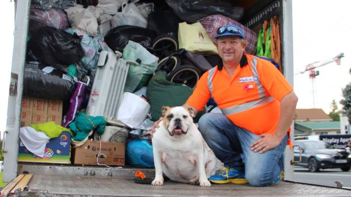 Marko Barber and his dog Louis. Marko is delivering donated goods to Edgecumbe for flood relief.