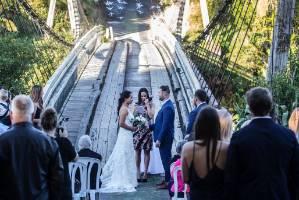 Taranaki couple Jarred Wallace and wife Samantha get married on the Bertrand Road Bridge, near Waitara.