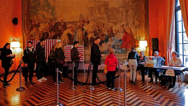 French start voting in oversea territories for presidential election