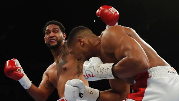 Dominic Breazeale (left) couldn't stop the onslaught of IBF world champion Anthony Joshua during their 2016 world title ...