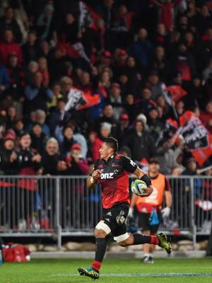 CHRISTCHURCH, NEW ZEALAND - APRIL 22: Pete Samu of the Crusaders runs through to score a try during the round nine Super ...