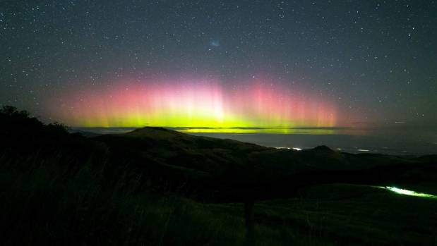 About 200 cars were at the top of the Port Hills, near Christchurch, as people went in search of a viewing point to see ...
