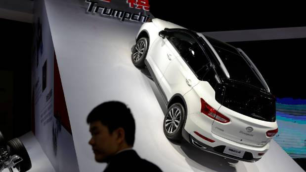 A man stands in front of Trumpchi GS4 from GAC Group at the 2017 Shanghai Auto Show.