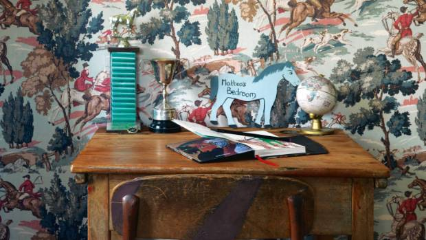 This hunting wallpaper has a vintage country vibe and perfectly pairs with the antique children's school desk.