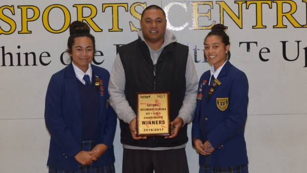 Wellington East Girls' College softball coach Steve Sila holds the division one trophy alongside co-captains Harmony ...