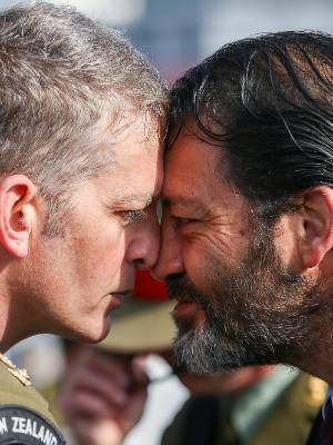 Willie Apiata greets a soldier with a hongi during the Anzac Day National Commemoration Service at Pukeahu National War ...