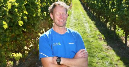 Saint Clair Vineyard Half Marathon director Chris Shaw among the vines, in Marlborough.