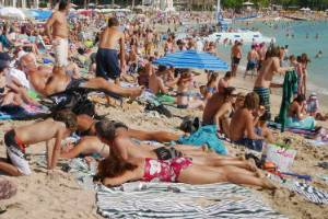 Tourists enjoy the sun on New Year's Day on Waikiki Beach in Honolulu, Hawaii.