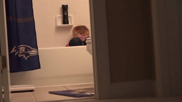 The boy is seen crying in the bath during a video in which his father yells at him.