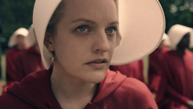 """Elizabeth Moss as Offred, literally """"Of Fred"""", or """"belonging to Fred"""") in Hulu's The Handmaid's Tale - where women no ..."""