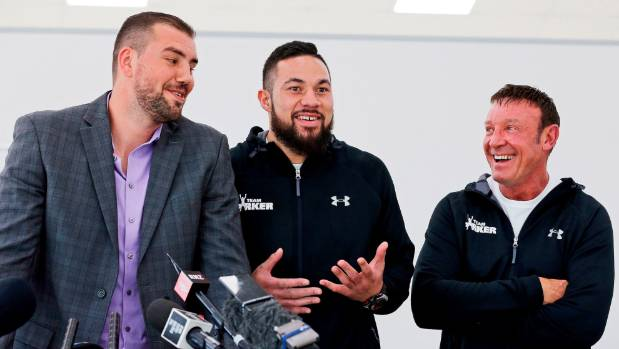 Joseph Parker, centre, is all smiles during a press conference with Razvan Cojanu, left, and Kevin Barry, right.