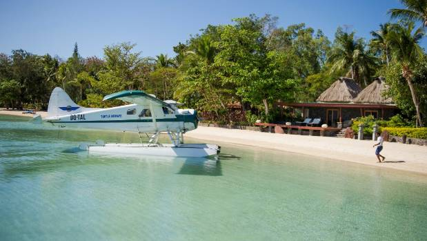 "From the moment guests are carried off the seaplane by grass-skirted Fijian ""warriors"", they are ""welcomed home"" by ..."