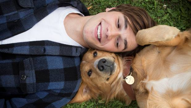 KJ Apa had to spent time bonding with canine actor Trip, who plays Bailey in A Dog's Purpose.