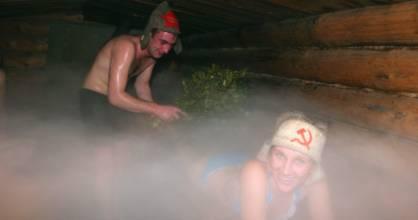 People enjoy a steam in a Russian banya.