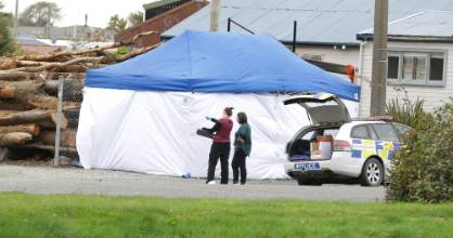A forensic tent at the Otepuni Ave address where Tuesday night's shooting took place.
