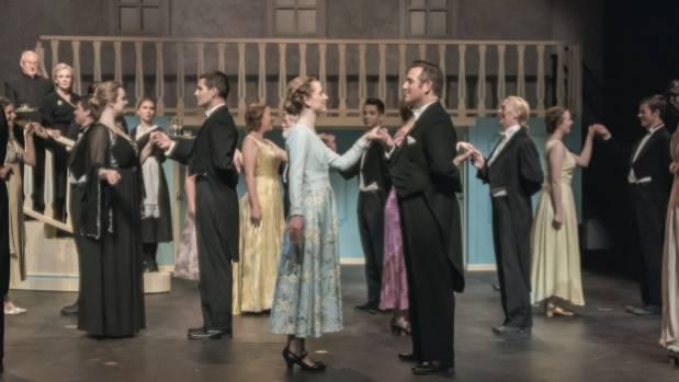 Maria (Shannon Peck) and Captain von Trapp (Gavin Hurley) in the centre of the ballroom scene.