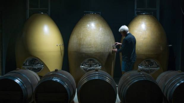 Bish tastes wine from his golden, concrete eggs. They will sit to one side of the oak egg in the new purpose-built winery.