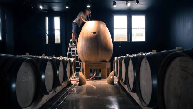 Bish looks into the oak egg, which will be the centre piece at his new winery.