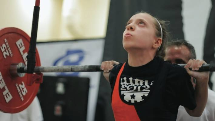 Pre-teen powerlifter breaks records and ignores bullies