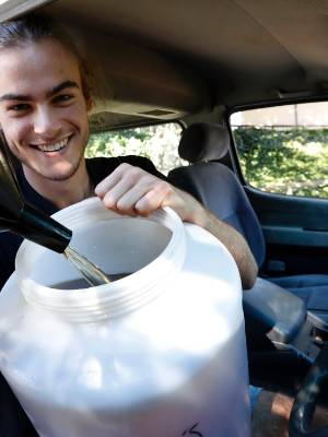 27042017 NEWS PHOTO MARTIN DE RUYTER/FAIRFAX NZNelson College student Neil MacMillan uses cooking oil from the ...