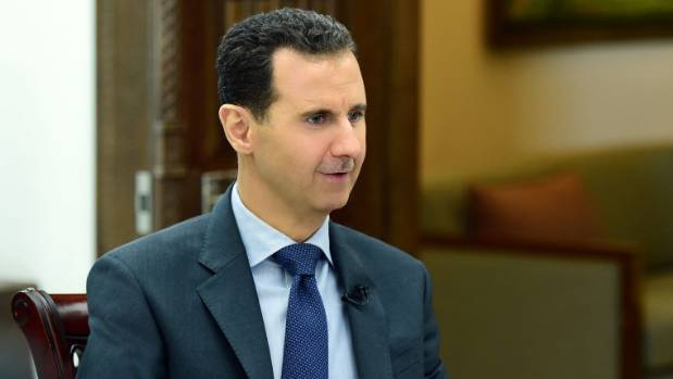 Syria's President Bashar al-Assad speaks during an interview with RIA Novosti and Sputnik in this handout picture ...