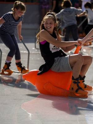 Holly Pearce, 12, enjoys her ride on the ice despite the surface water.