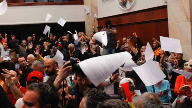 Politicians attacked as protesters storm Macedonian parliament