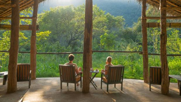 The Tree Tops Jungle Lodge has a glamping feel, despite being off-grid with no electricity or wi-fi.
