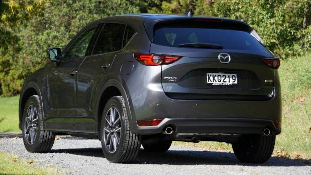 High-set, tiny lights give new CX-5 a distinctive look. There's 50 litres more luggage space, wider-opening doors.