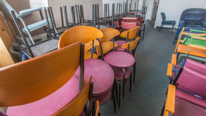 2114859660a Four thousand chairs and 50 oak doctors  desks needed new homes as a result  of