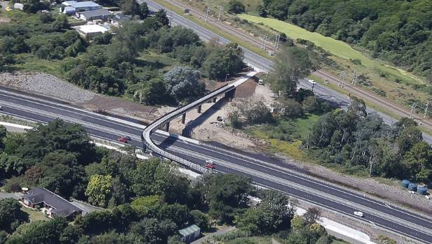 Old and new: the newly opened first section of the $630m Kapiti expressway at the bottom of the picture, with the old ...