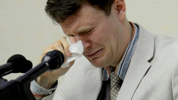 Warmbier tearfully confessed he had tried to steal a propaganda banner and was sentenced to 15 years of hard labour for ...