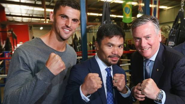 Boxer Manny Pacquiao (centre) poses  with AFL player Scott Pendlebury and Australian celebrity Eddie Maguire.